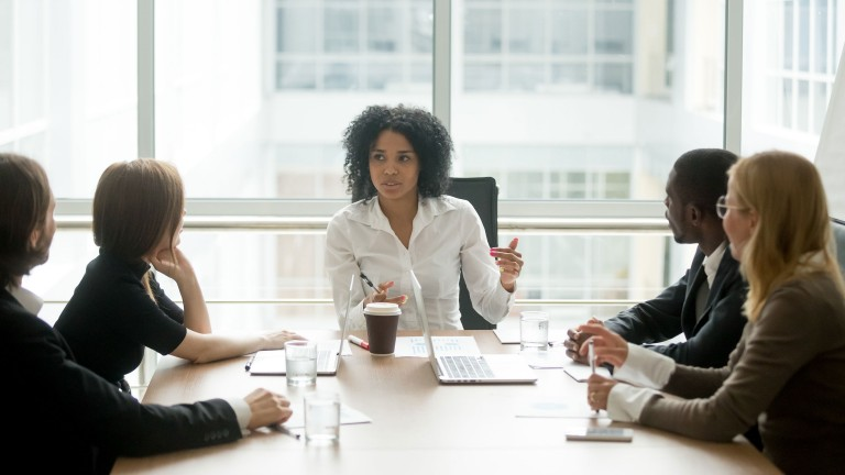 female-boss-leading-corporate-multiracial-team-meeting