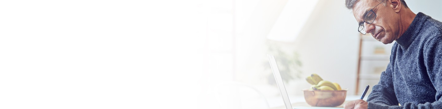 2880x1100 flipped horizontal left white gradient of a senior man using a laptop at home