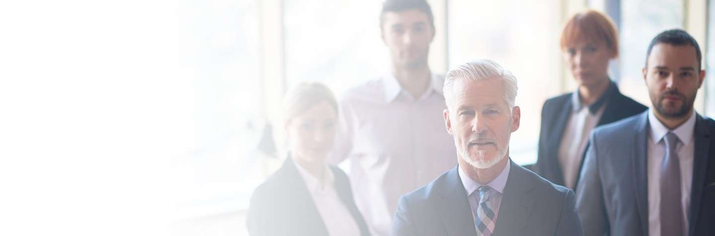 Cropped 2880x1100 left white gradient of senior businessman with his team at office. business people group